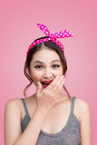 Surprised asian girl with pretty smile in pinup makeup style Royalty Free Stock Photos
