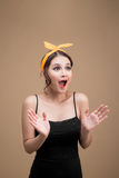 Surprised asian girl with pretty smile in pinup style on yellow Royalty Free Stock Photo