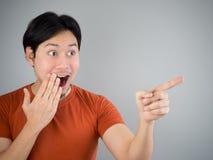 Surprised Asian man. Surprised Asian man pointing something Stock Photo