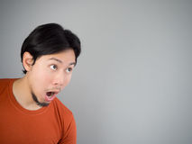 Surprised Asian man. Surprised Asian man in red t-shirt Stock Images