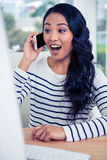 Surprised Asian woman on phone call Royalty Free Stock Image