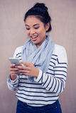 Surprised Asian woman using smartphone Royalty Free Stock Photography
