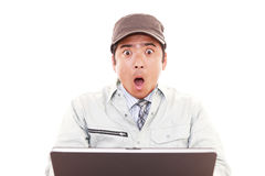 Surprised Asian worker Royalty Free Stock Photos