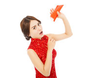 Surprised asian young woman point to a empty red envelope Stock Image