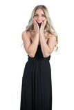 Surprised attractive blonde wearing black dress posing Royalty Free Stock Photography