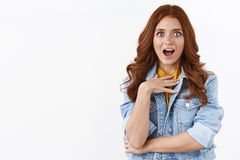 Free Surprised Attractive Redhead Girl In Denim Jacket, Look Ambushed And Impressed, Touch Chest From Astonishment, Gasping Royalty Free Stock Images - 162746749