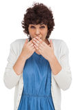 Surprised attractive woman placing hands on her mouth Stock Photos