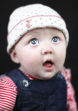 Surprised baby. With big blue eyes stock image