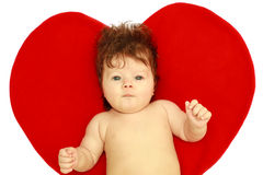 The surprised baby against heart Royalty Free Stock Photography
