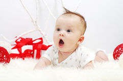 Surprised baby age of 3 months with gifts Royalty Free Stock Photos