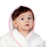 Surprised baby with bathrobe Stock Photo