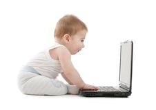 Surprised baby boy express working on laptop Royalty Free Stock Photos