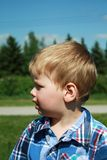 Surprised baby boy outside Royalty Free Stock Photo
