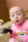 Surprised baby with cell phone Royalty Free Stock Image