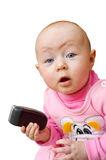Surprised baby with cell phone, isolated Stock Images