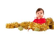 Surprised baby dress as santa looking at camera Royalty Free Stock Image