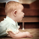 Surprised Baby on the Floor Stock Photo