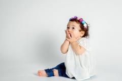 Surprised Baby Flower Headband On White Background Royalty Free Stock Image