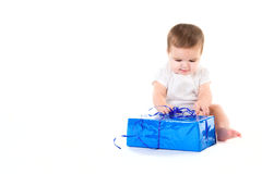 Surprised baby girl with gift Stock Image