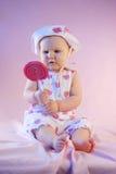 Surprised baby girl lollipop Royalty Free Stock Photos