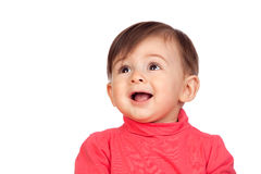 Surprised baby girl looking up Stock Image