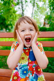 Surprised baby girl outside Royalty Free Stock Photography