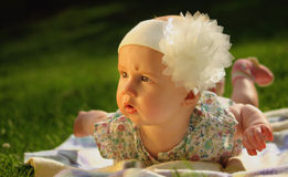 Surprised baby on green grass Stock Photography