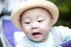 Surprised baby in hat Stock Image