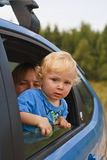 Surprised baby looking from car window Royalty Free Stock Photos
