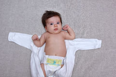 Surprised baby out of the body clothes Stock Images