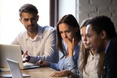 Free Surprised Baffled Diverse Colleagues Received Bad News By Email Stock Image - 147366611