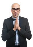 Surprised bald man in a suit and bow tie Royalty Free Stock Photography