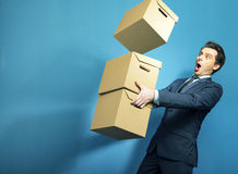 Surprised banker with the boxes Stock Images