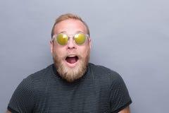 Surprised bearded man in sunglasses Stock Photos