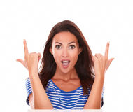 Surprised beautiful brunette lady pointing up Stock Images