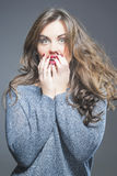 Surprised Beautiful Brunette Woman with Open Mouth and Lifted Bo Royalty Free Stock Image