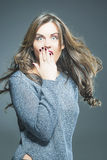 Surprised Beautiful Brunette Woman with Open Mouth and Lifted Ha Royalty Free Stock Photography
