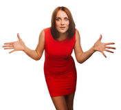 Surprised beautiful excited brunette woman. Throws up his hands opened her mouth in isolated in red dress Royalty Free Stock Photos