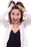Surprised beautiful girl with raised arms and open m Royalty Free Stock Image