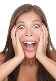 Surprised  - beautiful happy woman shocked. Funny surprised expression on a young woman's face. Asian caucasian person Stock Photos