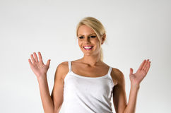 Surprised beautiful woman. In casual wear with raised arms Stock Image