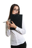 Surprised beautiful woman with a clipboard in his hands. Long-haired brunette in glasses and a white shirt. Shock, surprise. human Royalty Free Stock Images