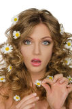 Surprised beautiful woman with daisies in hair. Surprised beautiful woman with daisies in curly hair Royalty Free Stock Photo