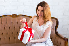 Surprised beautiful woman opening gift box Royalty Free Stock Photography