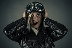 Surprised beautiful woman pilot. Isolated on gray Stock Images