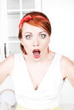 Surprised beautiful woman. With red hair Royalty Free Stock Images