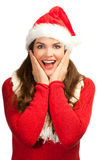 Surprised beautiful woman in santa hat Stock Photography