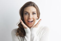 Surprised woman in sweater. Surprised beautiful woman in sweater, winter christmas gift concept Royalty Free Stock Photography
