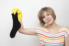 Surprised beautiful young woman with rubber gloves Royalty Free Stock Photography