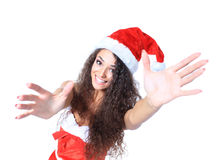 Surprised beautiful young woman in a Santa hat. Royalty Free Stock Photography